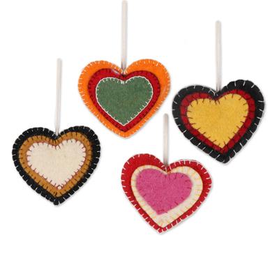 Wool felt ornaments, 'Entrancing Hearts' (set of 4) - Colorful Wool Felt Heart Ornaments from India (Set of 4)