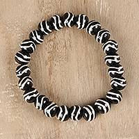 Bone beaded stretch bracelet, 'Black and White Glory' - Black and White Bone Beaded Stretch Bracelet from India