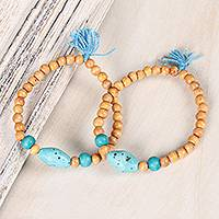 Wood and resin beaded stretch bracelets, 'Boho Friendship' (pair) - Wood and Blue Resin Beaded Stretch Bracelets (Pair)