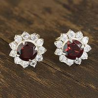 Garnet stud earrings, 'Gleaming Flower' - Floral Garnet Stud Earrings Crafted in India