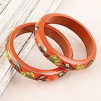 Wood bangle bracelets, 'Vermilion Garden' (pair) - Floral Haldu Wood Bangle Bracelets in Vermilion (Pair)
