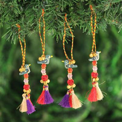 Wood beaded ornaments, 'Chirping Birds' (set of 4) - Bird-Themed Wood Beaded Ornaments from India (Set of 4)