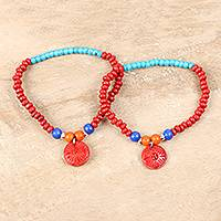 Bone and wood beaded stretch bracelets, 'Energetic Colors' (pair) - Colorful Bone and Wood Beaded Stretch Bracelets (Pair)