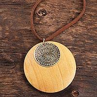 Wood and brass pendant necklace, 'Royal Circle' - Floral Haldu Wood and Brass Pendant Necklace from India