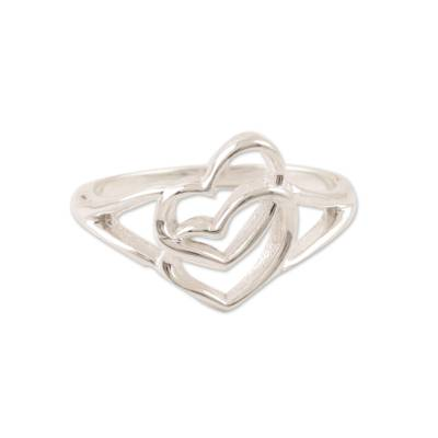 Sterling silver band ring, 'Hearts United' - Romance-Themed Sterling Silver Heart Band Ring from India