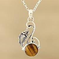 Tiger's eye pendant necklace, 'Honey Bud' - Modern Tiger's Eye and Sterling Silver Necklace from India