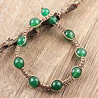 Onyx beaded bracelet, 'Green Planets' - Hand-Knotted Green Onyx Macrame Bracelet from India