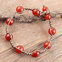 Carnelian beaded bracelet, 'Bright Planets' - Hand-Knotted Carnelian Beaded  Macrame Bracelet from India