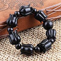 Ebony wood beaded stretch bracelet, 'Blooming Charm' - Handcrafted Ebony Wood Beaded Stretch Bracelet