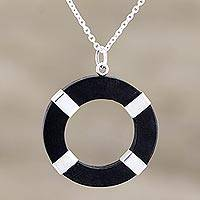 Sterling silver and ebony wood pendant necklace, 'Bright Ring' - Hand Crafted Sterling Silver and Ebony Wood Pendant Necklace