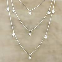 Sterling silver charm necklace, 'Starry Eyes' - Hand Crafted Sterling Silver Star Charm Necklace