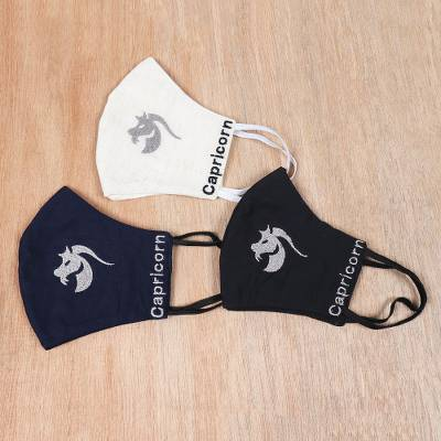 Embroidered cotton face masks, 'Hardworking Capricorn' (set of 3) - Embroidered Cotton Capricorn-Themed Face Masks (Set of 3)