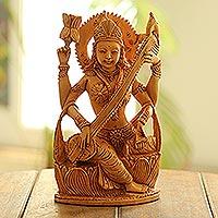 Wood sculpture, 'Saraswati Plays'