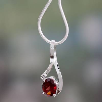 Garnet necklace, 'Love in a Ribbon' - Handcrafted Indian Sterling Silver Pendant Garnet Necklace
