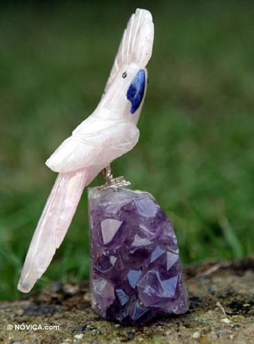Carved rose quartz and amethyst stone bird sculpture