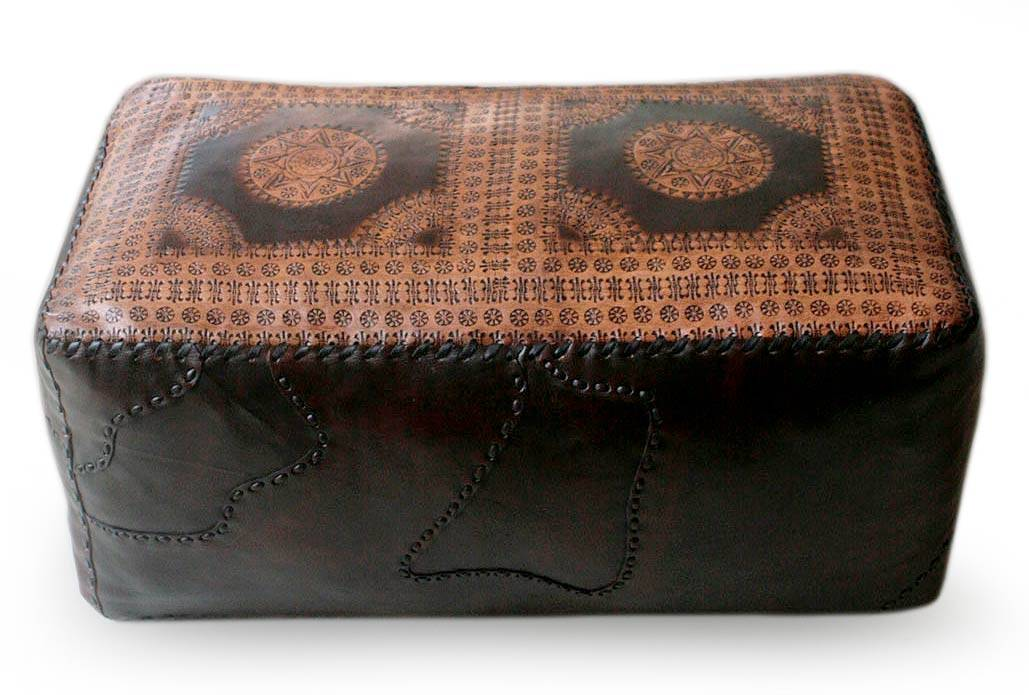 Hand tool leather ottoman cover by Carneiro Family