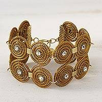 Gold plated golden grass link bracelet, 'Spiral Play' - Golden Grass and Rhinestone Spiral Motif Wristband Bracelet