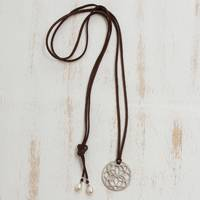 Cultured pearl lariat necklace, 'Rustic Lotus' - Cutwork Lotus Round Brass Pendant Leather Cord Necklace