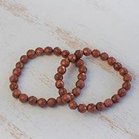 Sunstone beaded stretch bracelets, 'Strength and Energy' (pair) - Two Sunstone Beaded Stretch Bracelets from Brazil
