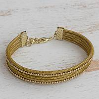 Gold accented golden grass wristband bracelet, 'Gleam of the Sun' - Gold Accented Golden Grass Wristband Bracelet from Brazil