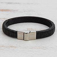 Men's leather wristband bracelet, 'Fearless Power' - Men's Black Leather Wristband Bracelet Stainless Steel Clasp