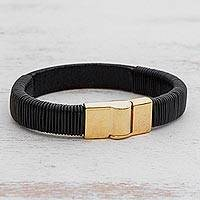 Leather wristband bracelet, 'Fearless Strength' - Black Leather Wristband Bracelet Gold-Toned Steel Clasp