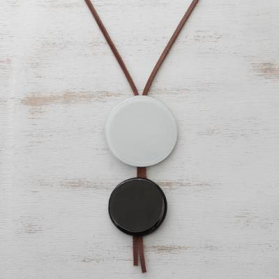 Glass and leather pendant necklace, 'Circular Modernity' - Black and White Glass and Leather Pendant Necklace