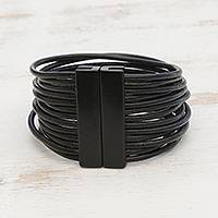 Leather strand bracelet, 'Powerful Together in Black' - Black Leather Cord and Stainless Steel Strand Bracelet