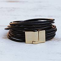 Leather cord bracelet, 'Golden Lunar Rotations' - Brazilian Black Leather Cord Bracelet w/ Golden Clasp