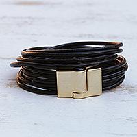 Leather cord bracelet, 'Golden Lunar Rotations' - Brazilian Black Leather Cord Bracelet w/ Golden Clasp