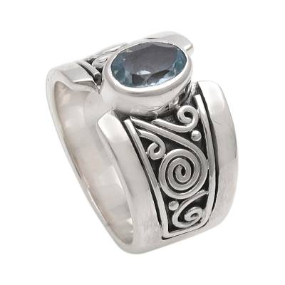 Blue topaz single stone ring, 'Blue Karma' - Artisan Crafted Sterling Silver Wide Ring with Blue Topaz