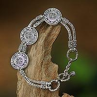 Sterling silver charm bracelet, 'Coins of the Kingdom' - Indonesian Good Fortune Sterling Silver Bracelet