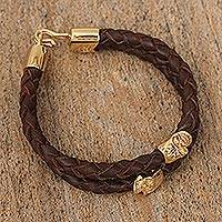 Gold-accented braided leather pendant bracelet, 'Death and Life' - Mexican Double Strand Braided Leather Bracelet in Brown