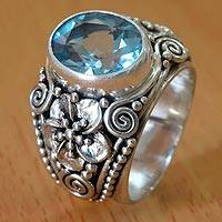 Blue topaz cocktail ring, 'Blue Frangipani' - Blue Topaz Cocktail Ring in Sterling Silver