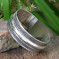 Sterling silver cuff bracelet, 'Captivated'