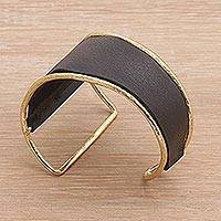 Leather and brass cuff bracelet, 'Golden Black Swirl' - Golden Black Leather and Brass Cuff Bracelet from Bali