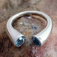 Blue topaz wrap ring, 'Face to Face'