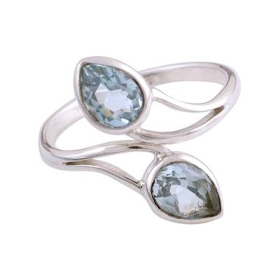 Rhodium plated blue topaz wrap ring,