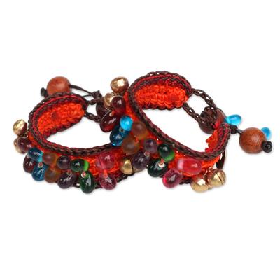 Beaded wristband bracelets, 'Bold Orange Fortunes' (pair) - Handcrafted Beaded Wristband Bracelets (Pair)