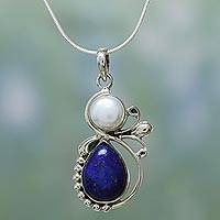 Cultured pearl and lapis lazuli pendant necklace, 'Midnight Moon' - Hand Made Women's Sterling Silver Lapis Lazuli and Pearl