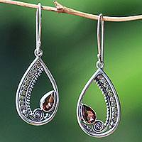 Garnet dangle earrings, 'Paisley Swirl' - Sterling Silver Garnet Dangle Earrings from Indonesia