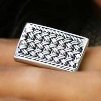 Sterling silver band ring, 'Woven Elegance' - Braid Motif Handcrafted Sterling SiIlver Cocktail Ring