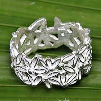 Sterling silver band ring, 'Frangipani Circle' - Artisan Crafted Sterling Silver Floral Ring from Bali