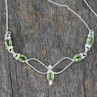 Peridot pendant necklace, 'Flight' - Handcrafted Sterling Silver and Peridot Necklace