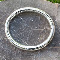 Sterling silver bangle bracelet, 'Oval Halo' - Oval Silver Bangle