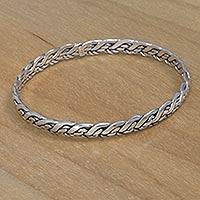 Sterling silver bangle bracelet, 'Infinity Waves' - Artisan Crafted Sterling Silver Bangle Bracelet from Bali