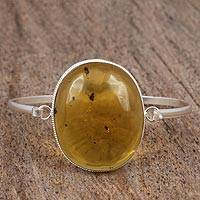 Amber pendant bangle bracelet, 'Sunstruck' - Natural Amber and Sterling Silver Bangle Pendant Bracelet
