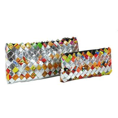 Recycled metalized wrapper cosmetic bags, 'Shine' (pair) - Recycled metalized wrapper cosmetic bags