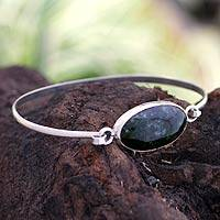 Jade bangle bracelet, 'Green Lagoon' - Handcrafted Sterling Silver Jade Bangle Bracelet