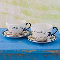 Ceramic cups and saucers, 'Margarita' (pair) - Hand Painted Floral Ceramic Tea Cups and Saucers (Pair)